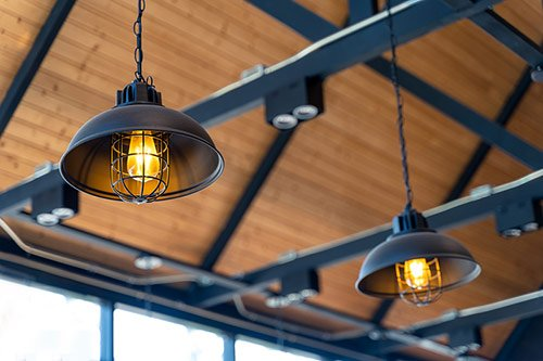 Hanging Edison lamps from a wood ceiling top view