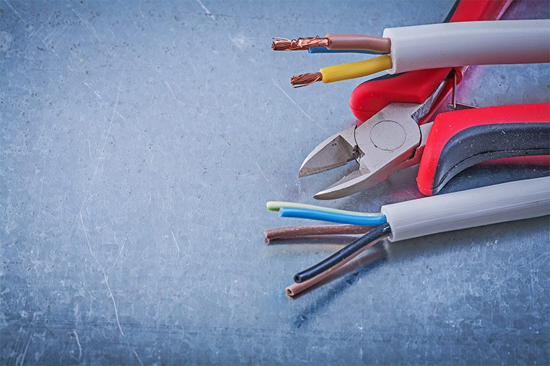 Zoomed in stripped electrical wires and wire cutters